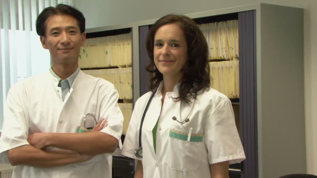 ms portrait of two doctors in medical office / helmond, north brabant, netherlands - ナースステーション点の映像素材/bロール