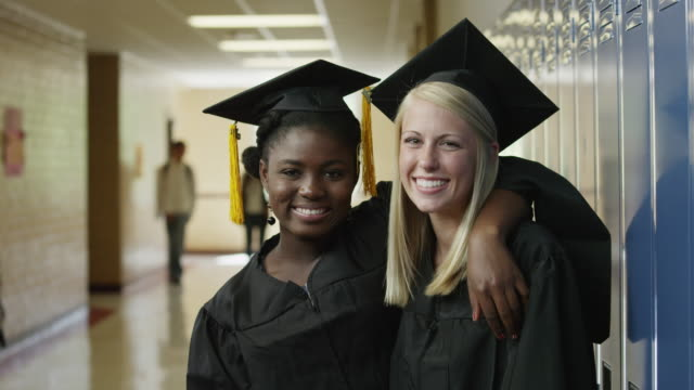 ms zi portrait of two female graduates (16-17) in school corridor / spanish fork city, utah, usa - secondary school child stock videos & royalty-free footage