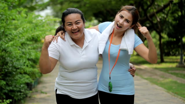 portrait of two fit young women smiling - overweight active stock videos & royalty-free footage