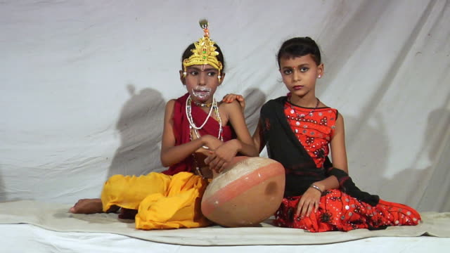 WS Portrait of two girls impersonating Radha and Krishna on eve of Janmashtami / Delhi, India