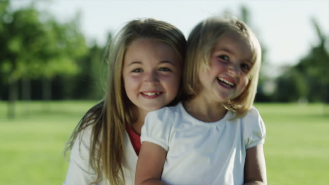 stockvideo's en b-roll-footage met ms portrait of two girls (4-5, 10-11) in park / orem, utah, usa - orem utah