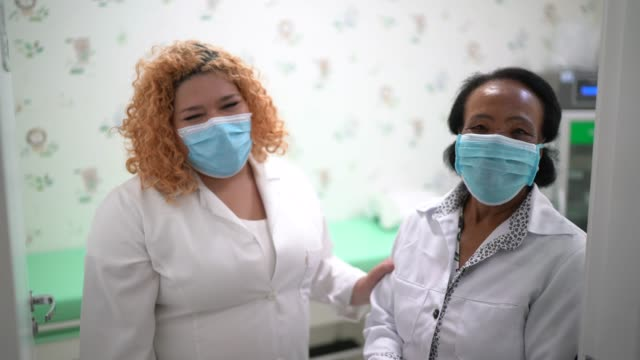 portrait of two happy female doctors - heroes stock videos & royalty-free footage