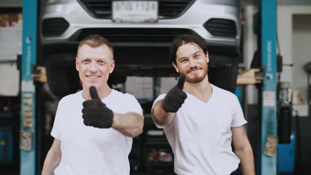 portrait of two mechanic - machine part stock videos & royalty-free footage