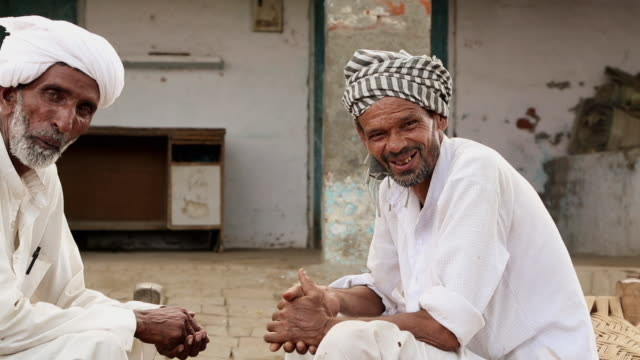 Portrait of two senior men smiling, Haryana, India
