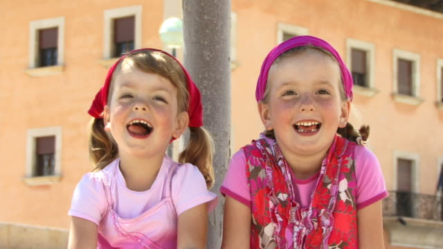 cu, portrait of two sisters (4-5, 6-7) laughing, spain, balearic islands, mallorca, palma - palma stock videos & royalty-free footage