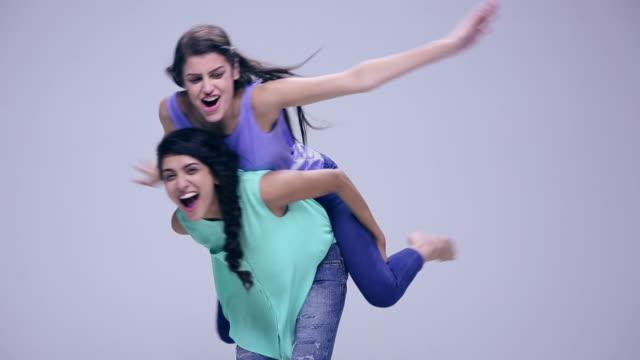 Portrait of two young women enjoying