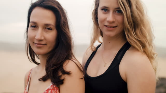 portrait of two young women looking at camera - algarve stock-videos und b-roll-filmmaterial