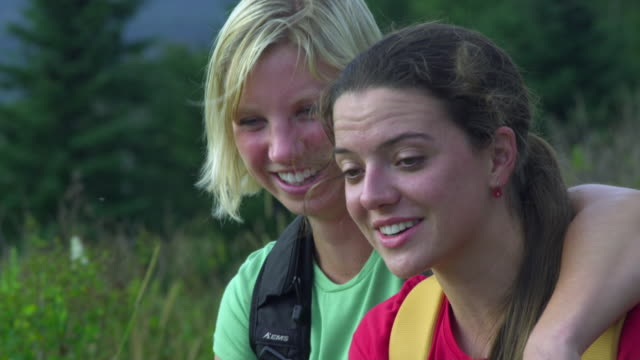 cu portrait of two young women smiling, rangeley, maine, usa - mid length hair stock videos & royalty-free footage