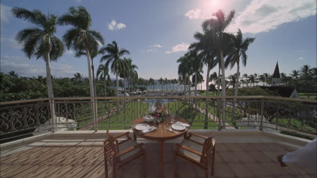 DS, WS, Portrait of waiter at set table on terrace in luxurious resort, Maui, Hawaii, USA