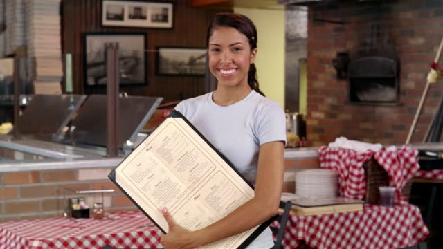 portrait of waitress holding menu in pizza restaurant - hearth oven stock videos & royalty-free footage