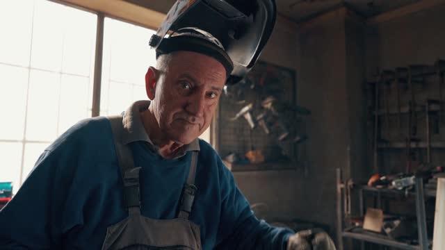 portrait of welder in the workshop - welding helmet stock videos & royalty-free footage