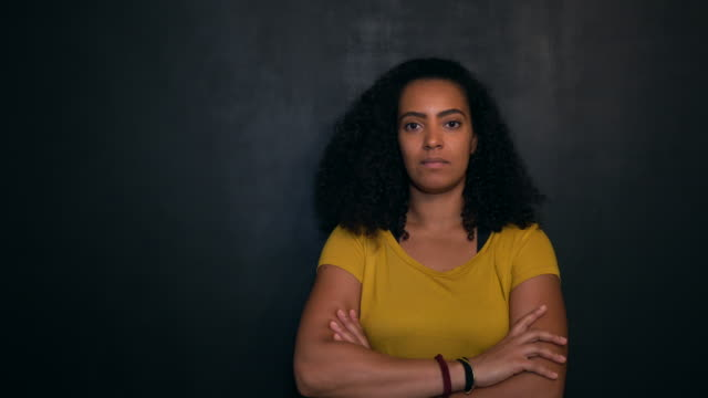 portrait of woman against black wall - black civil rights stock videos & royalty-free footage