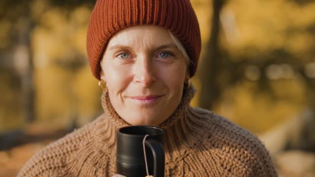 portrait of woman enjoying tea in autumn - only women stock videos & royalty-free footage