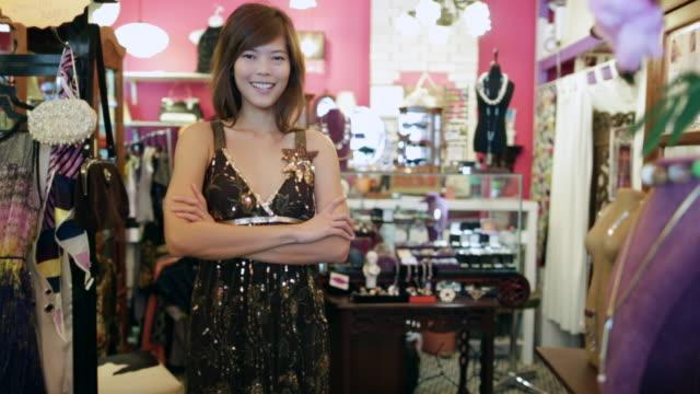 WS Portrait of woman in vintage clothes shop