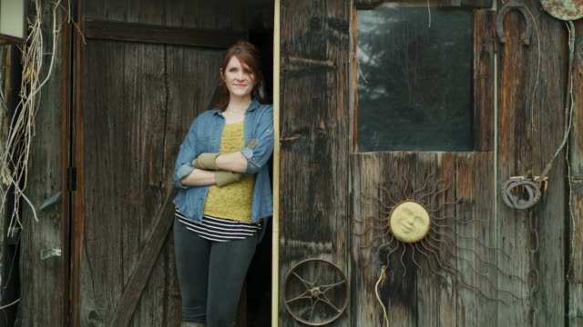 portrait of woman leaning in doorway of rustic barn / provo, utah, united states - provo stock videos & royalty-free footage
