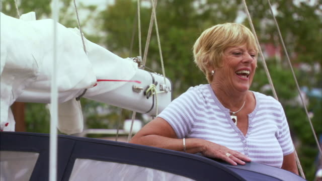 ms portrait of woman on sailboat, halifax, nova scotia, canada - blonde hair stock videos and b-roll footage