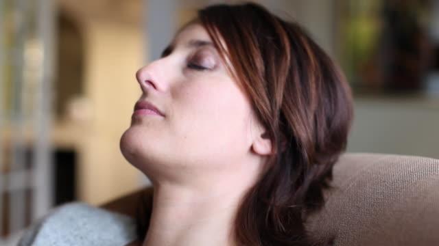 CU Portrait of woman resting on sofa / Brussels, Brabant, Belgium