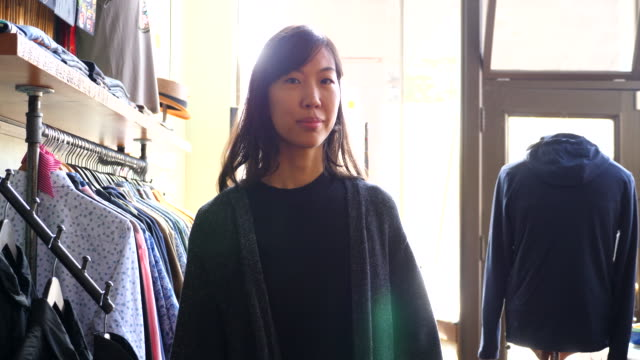 ms portrait of woman shopping in clothing boutique - cardigan sweater stock videos & royalty-free footage