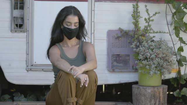 portrait of woman sitting on doorstep - doorway stock videos & royalty-free footage