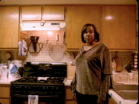 ms, portrait of woman standing in kitchen, reno, nevada, usa - 主婦業点の映像素材/bロール