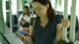 Portrait of   woman using mobile phone while traveling