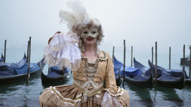 portrait of woman wearing historical clothing and carnival mask by canal - historical clothing stock videos & royalty-free footage