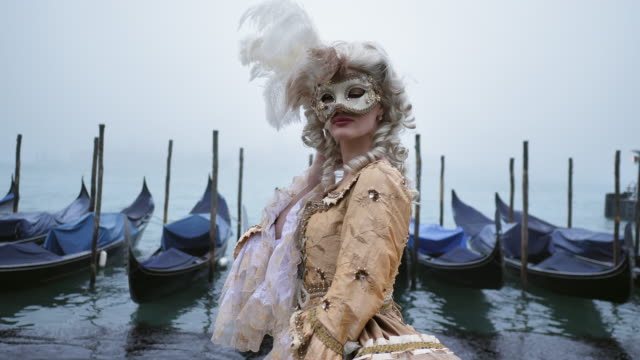portrait of woman wearing historical clothing and carnival mask by canal - italian culture stock videos & royalty-free footage