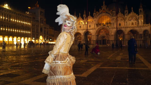 portrait of woman wearing historical clothing and carnival mask on st mark's square at night - historical clothing stock videos & royalty-free footage
