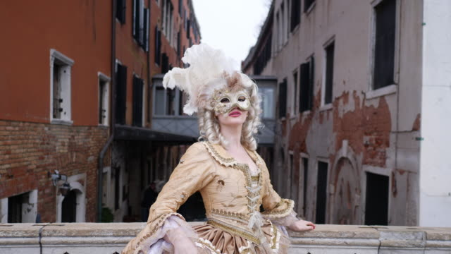 portrait of woman wearing historical clothing and carnival mask on footbridge - historical clothing stock videos & royalty-free footage