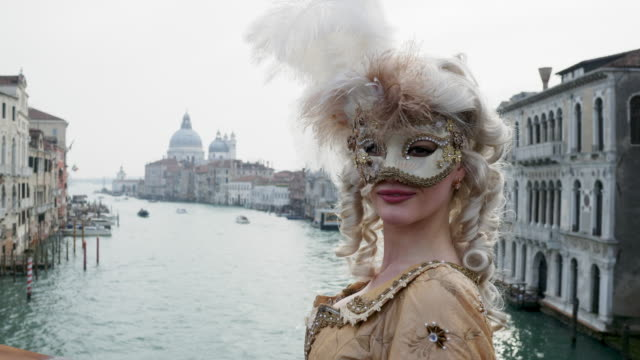 portrait of woman wearing historical clothing and venetian mask by canal - italian culture stock videos & royalty-free footage