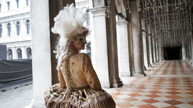 portrait of woman wearing historical clothing and venetian mask in arcade - venice italy stock videos & royalty-free footage