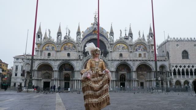 portrait of woman wearing historical clothing and venetian mask on st mark's square - historical clothing stock videos & royalty-free footage