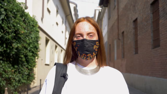 portrait of woman wearing mask - mid length hair stock videos & royalty-free footage
