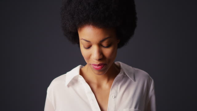 Portrait of woman with afro and white blouse
