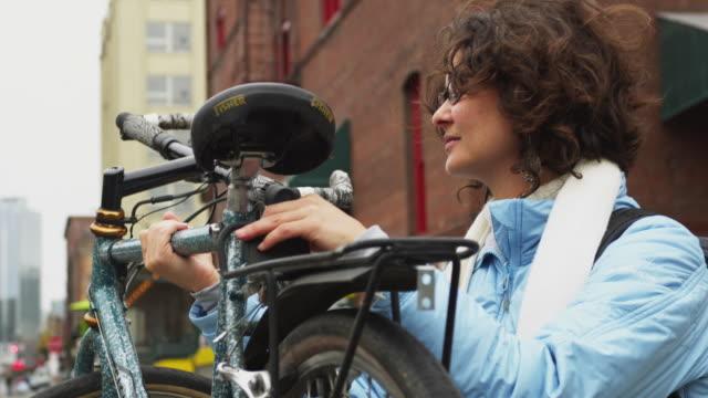 cu portrait of woman with bicycle / portland, oregon, usa - portland oregon bike stock videos & royalty-free footage