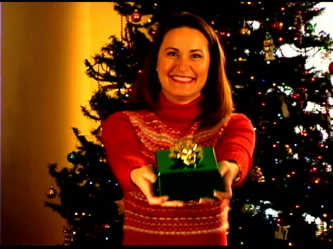 portrait of woman with christmas gift - see other clips from this shoot 1407 stock videos and b-roll footage
