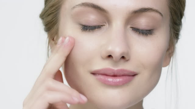 portrait of woman with glossy lips applying cream - skin stock videos & royalty-free footage