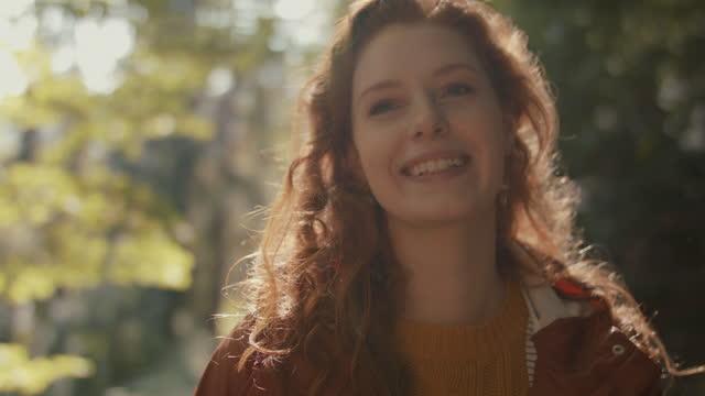 portrait of woman with long red hair smiling - シュバルツバルト点の映像素材/bロール