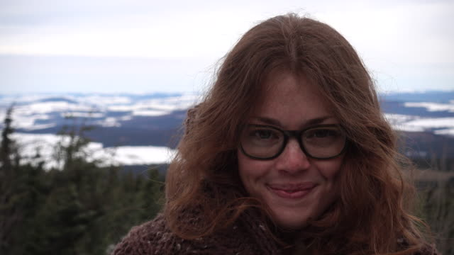 portrait of woman with specs on a hill - spectacles stock videos & royalty-free footage