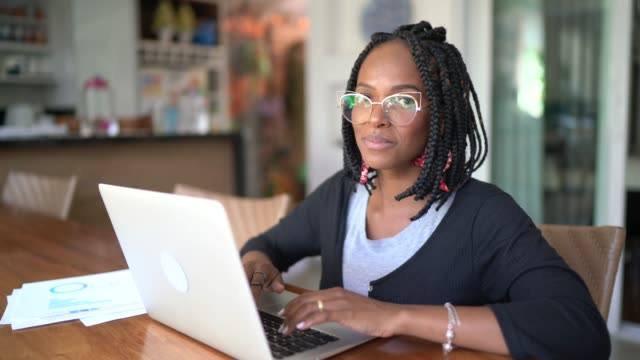 portrait of woman working from home - braided hair stock videos & royalty-free footage