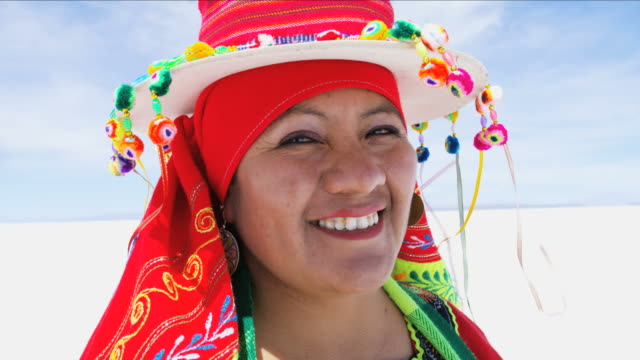 portrait of women in national headdress salt flats - cappello video stock e b–roll