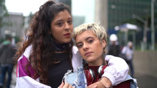 Portrait of women lesbians embracing outdoors