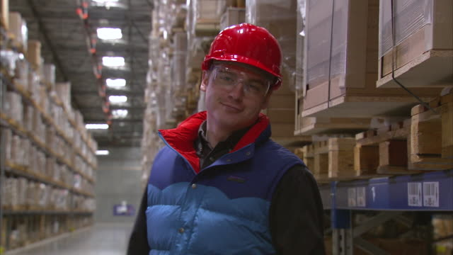 CU Portrait of worker in warehouse / LeBec, CA, United States