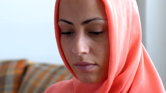 Portrait of worried Muslim woman