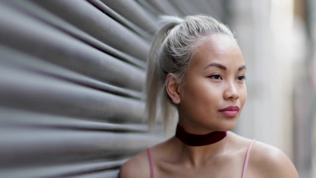 portrait of young adult female with urban background - pacific islander background stock videos & royalty-free footage