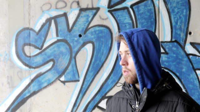 portrait of young adult graffiti artist - obscene gesture stock videos and b-roll footage