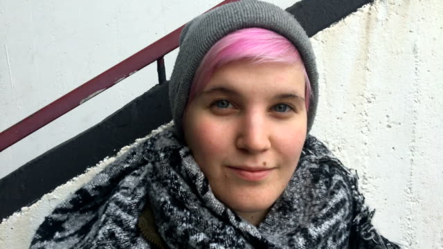 portrait of young adult millenial woman on ciy street - pink hair stock videos & royalty-free footage