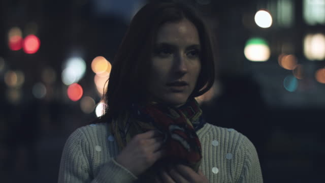 portrait of young adult woman on street in new york - adjusting stock videos and b-roll footage