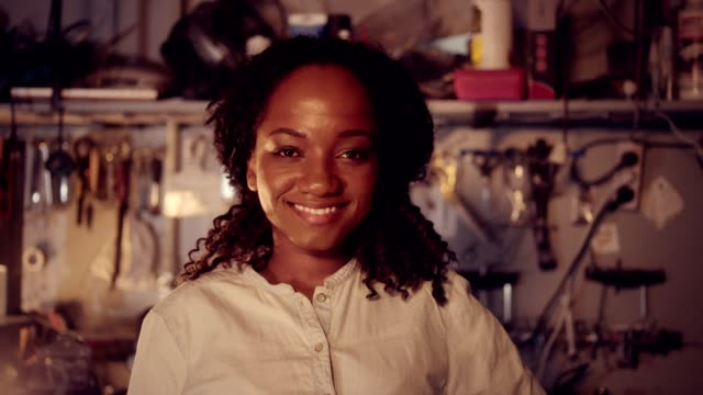 portrait of young african ethnicity woman in workshop. - gender stereotypes stock videos & royalty-free footage