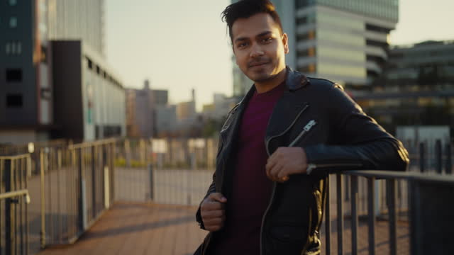 portrait of young and handsome indian man in city during sunset - leather jacket stock videos & royalty-free footage